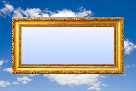 Frame Of Fame (Blank Golden Picture Frame Against Blue Sky) photo