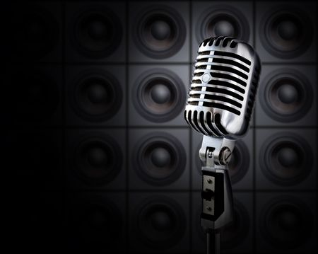 singer on stage: Tonight Show (Retro Microphone In Spotlight Against Wall Of Speakers) Stock Photo