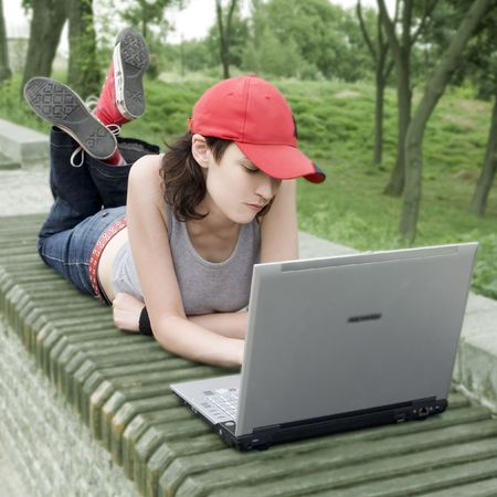 Computer Generation (TeenagerStudent In A Park With Laptop)