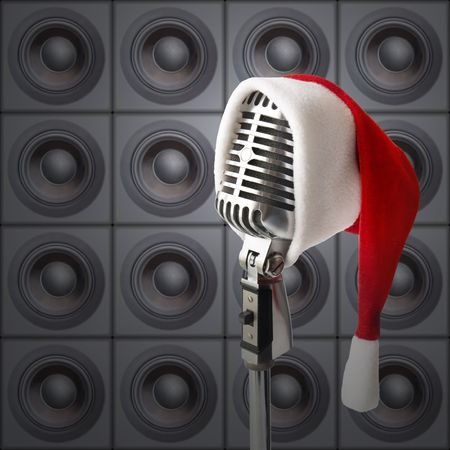 song: New Years Party! (Retro Mike In Santa Hat In Front Of Speakers Wall) Stock Photo