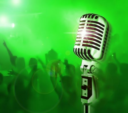 Show Time (Professional Microphone & Crowd Of Fans On A Background) Stock Photo