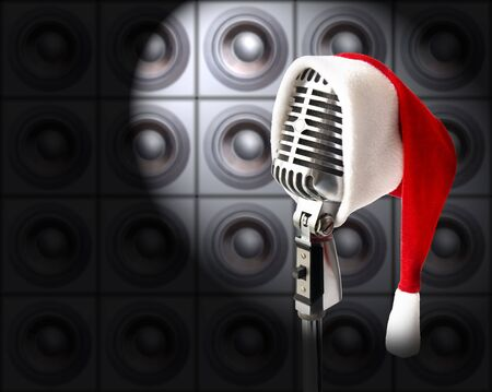 santa outfit: New Years Party! (Retro Mike In Santa Hat In Spotlight Against Speakers Wall) Stock Photo