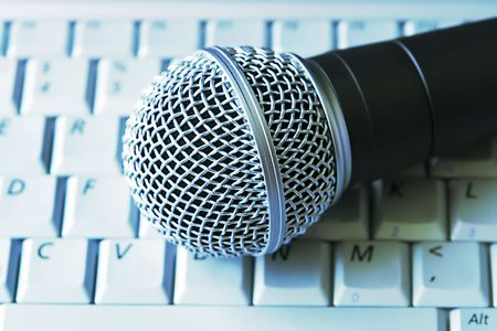 shure: Professional Microphone On Laptop Keyboard Stock Photo
