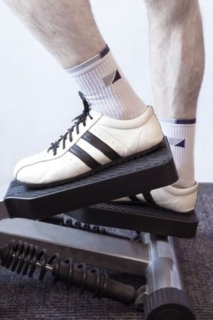 cardiovascular workout: Fitness (Mans Legs On A Fitness Machinery)