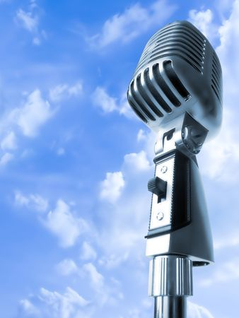 shure: High Time For Rockin! (Vintage Elvis Microphone Over Blue Sky) Stock Photo