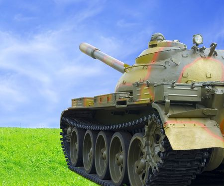 Threat Of War (Military Tank On Green Grass Against Blue Sky) photo
