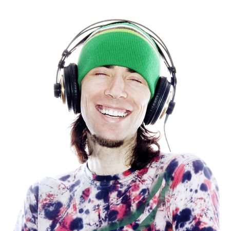 Enjoying His Music (Smiling Teenager With Headphones Enjoying His Music)