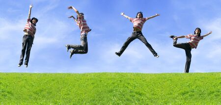 Energy Of Youth (Young Man Jumping Happy On Meadow) Stock Photo