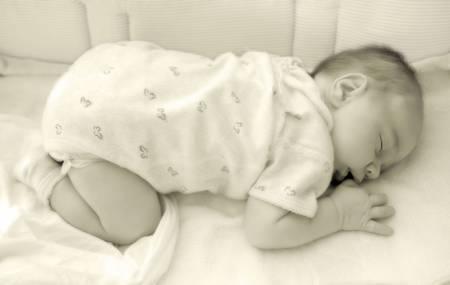 Newborn Baby Sleeping In His Cradle