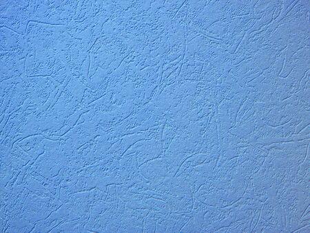 Light blue woodchip wallpaper as background photo