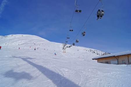 Slope under a chairlift photo