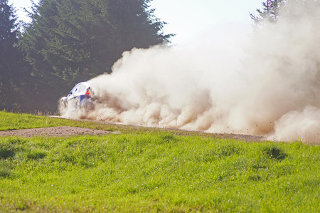 unsurfaced road: Rally car on a dirt road