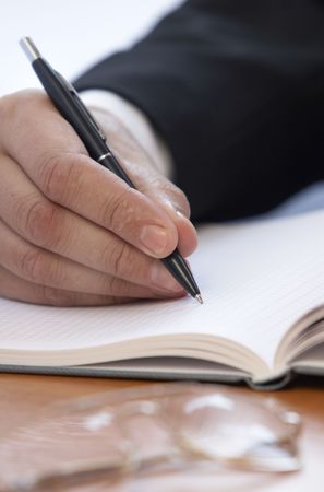 close up of  businessman hand writing photo