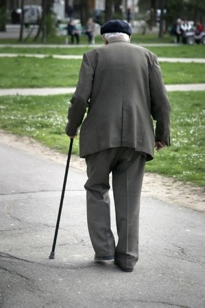 guy with walking stick: old man walking Stock Photo