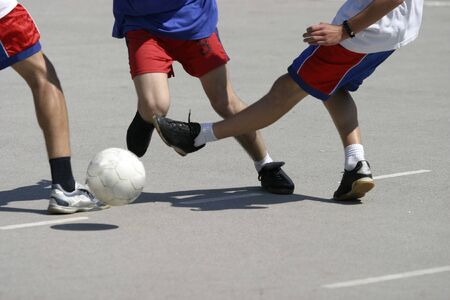 close up og soccer players legs and ball in action photo