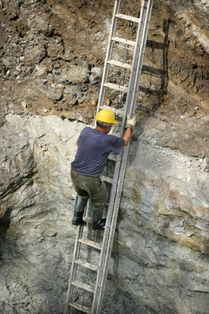 worker climbing on construction site photo