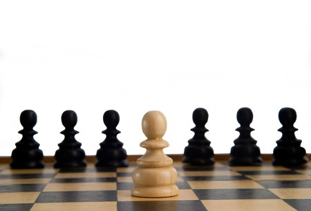 chess pieces on the board on white background with path photo