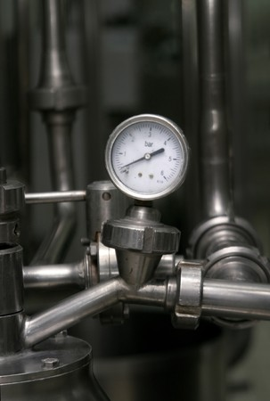 teknik: close up of industrial pipes and measurer of compression Stockfoto