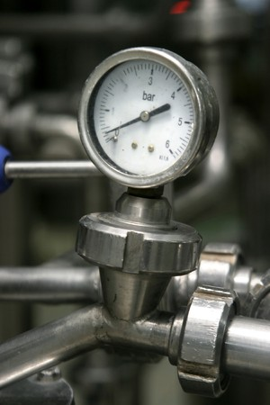 naphtha: close up of industrial pipes and measurer of compression Stock Photo