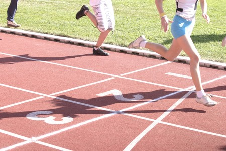 close up runners on on finishing line Stock Photo - 4076257