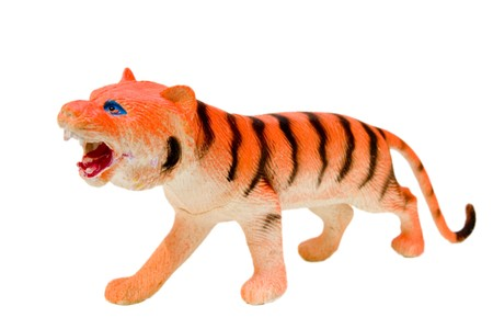 rubber tiger on white background with path photo