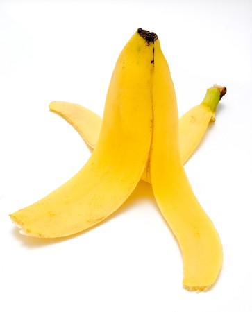 ailment: still life of peeled banana on white background with path