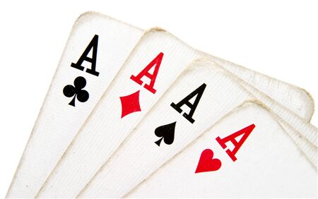 hand of cards of four aces of playing cards on white background with path photo