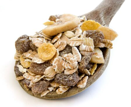 close up of ready to use muesli on white background with path photo