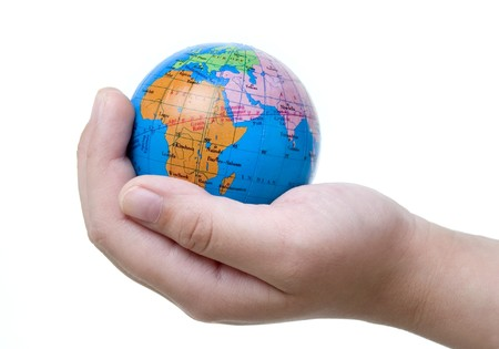 outerspace: child holding miniature of the earth on white background with path