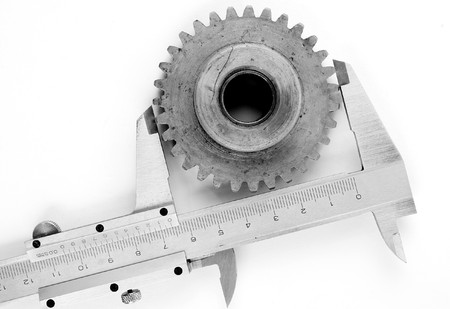 vernier measuring tool scale and mechanical machine part on white background photo