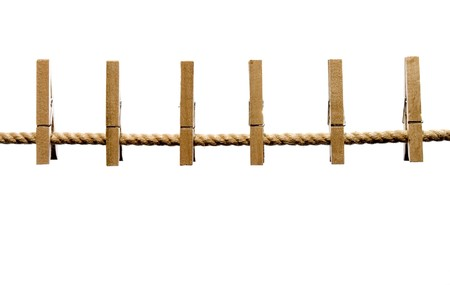 close up of wooden clothespins on a line and on white background with path included photo