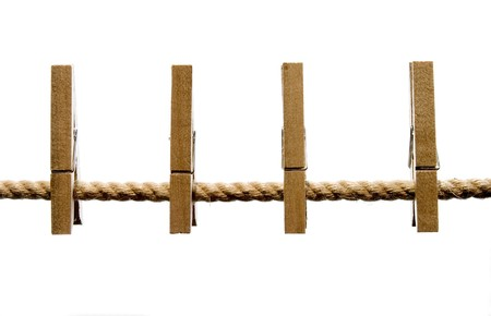 clothespins: close up of wooden clothespins on a line and on white background with path included