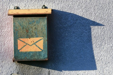 close up of old mailbox on house wall photo