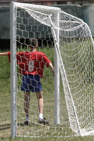 young boys soccer player in the field photo