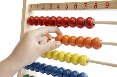 �aucasian: child hand over math problem counting abacus Stock Photo