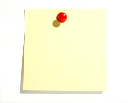 drawing pins: close up of yellow note pad reminder on wall, with path Stock Photo