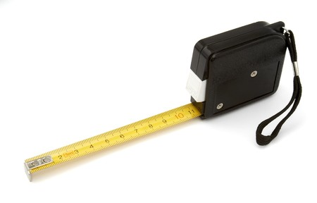 measures white house: close up of tape measurer for construction workers on white background with path
