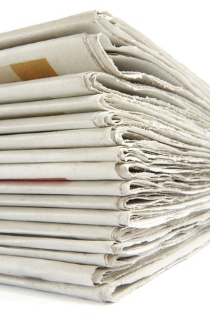 close up of newspapers on white background photo