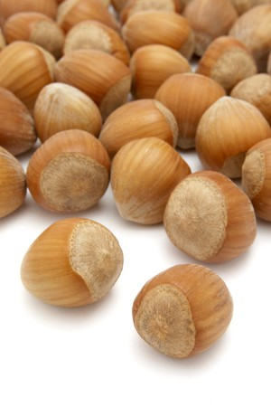 nutshell: close up of hazelnuts  in nutshell on white background