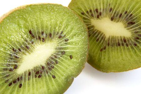 close up of green kiwi on white background photo