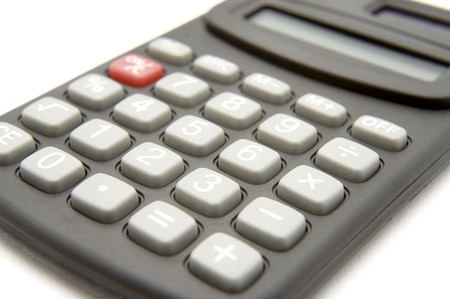 close up of calculator on white background  photo