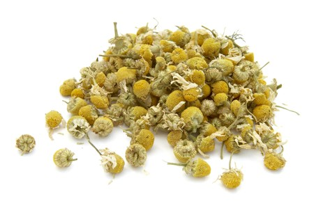 dried herb: close up of dried chamomile flowers on white background with path, shadow not included