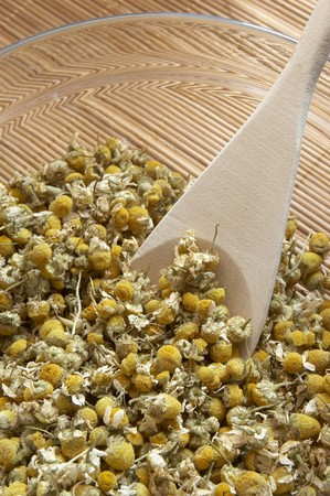close up of dried chamomile flowers on table photo