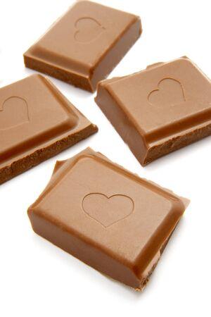close up of chocolate bar on white background photo