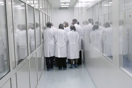 visitors in white coats in interior of a pharmaceutical industry Stock Photo - 4274342
