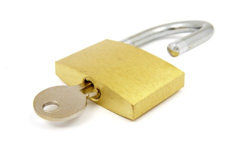 close up of padlock and key on white background with path, shadow not included Stock Photo