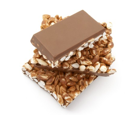 puffed: close up of chocolate with puffed rice bar on white background