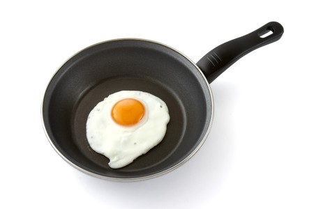 close up of fried egg in pan on white background Stock Photo - 4297249
