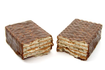 close up of chocolate wafers on white background