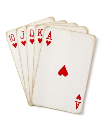 close up of straight flush of playing cards poker game on white background  photo